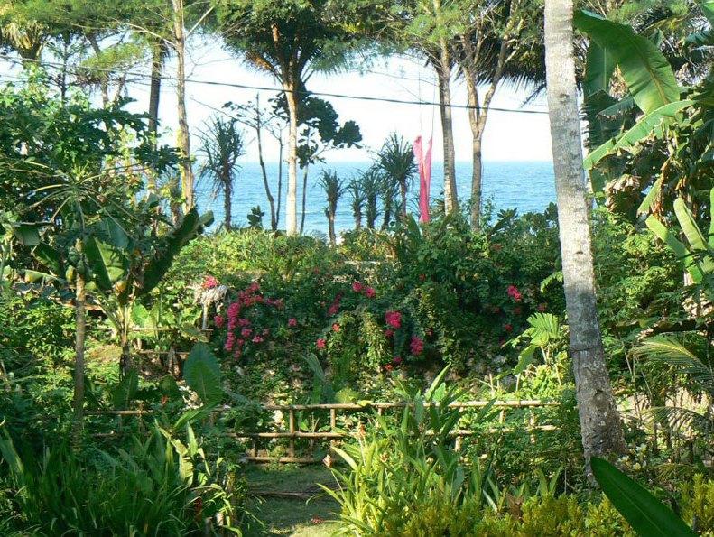 Tuin met vergezichten op strand